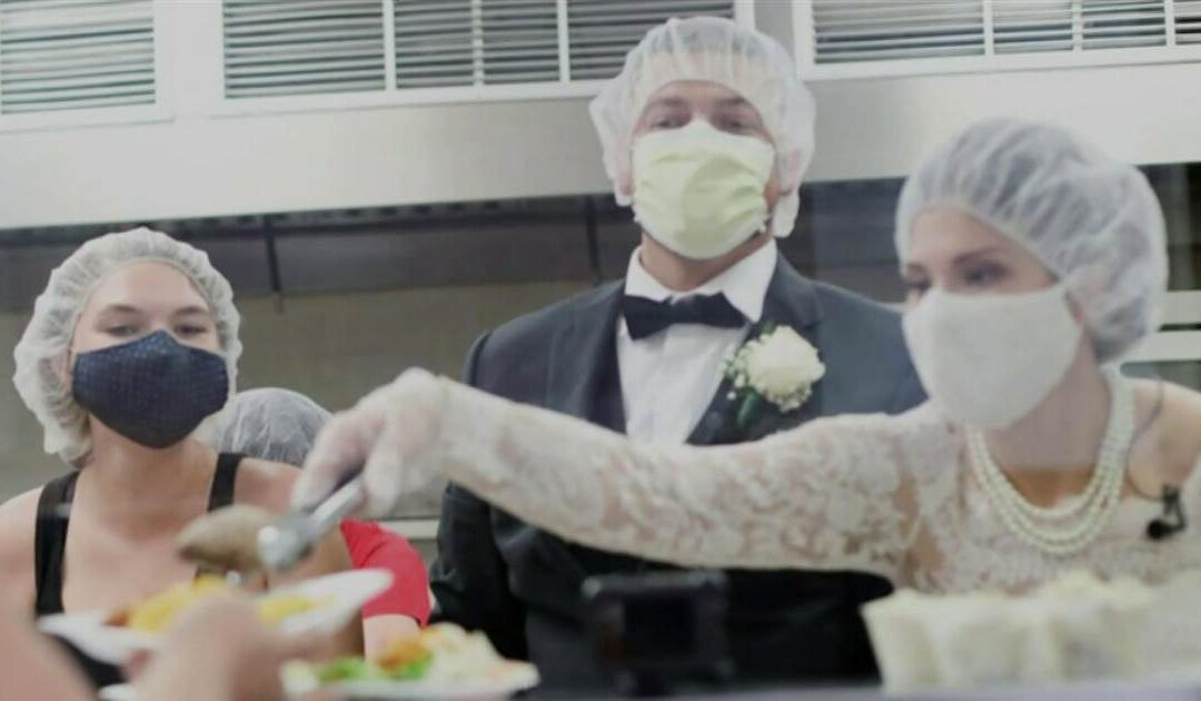 Newlyweds donate and serve food from canceled wedding to those in need