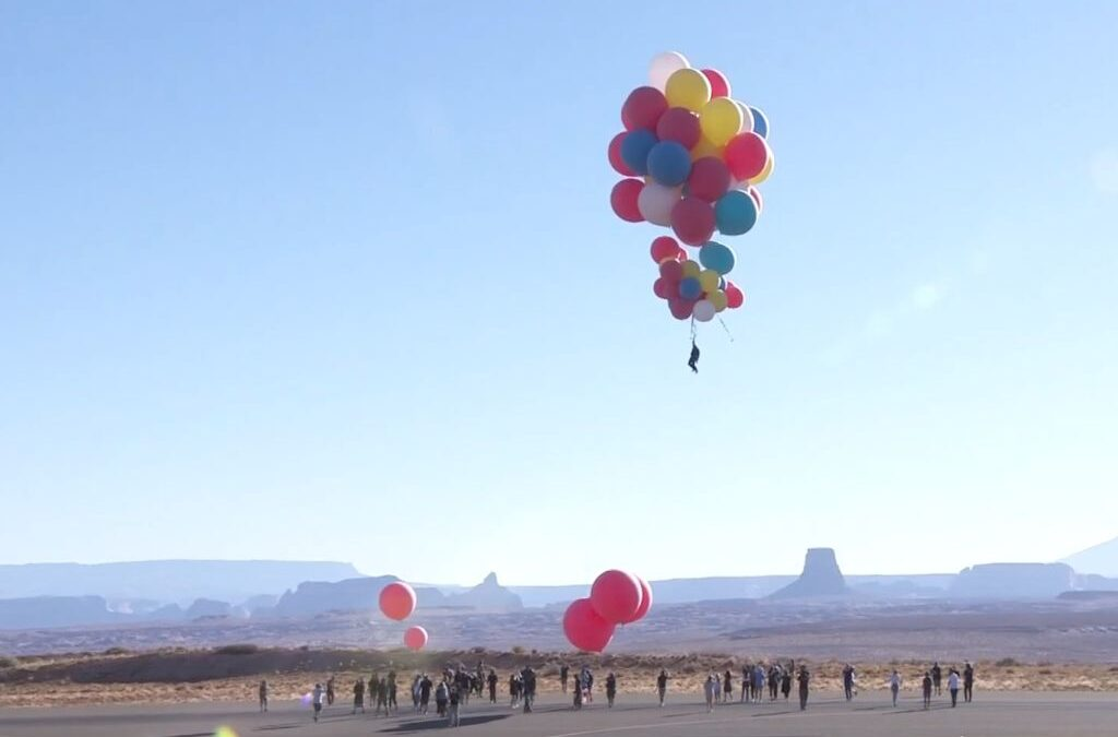 David Blaine floats away holding a bunch of helium balloons