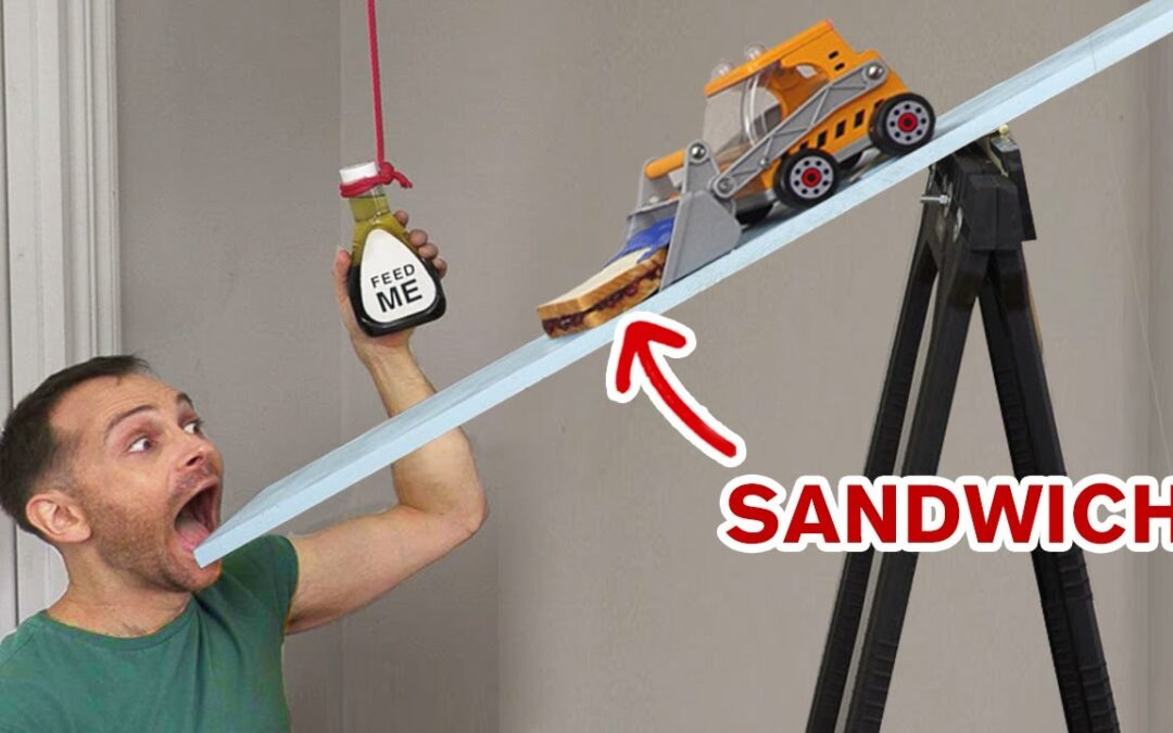 Guy makes Rube Goldberg machine to make a sandwich and vote at the same time